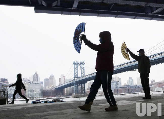 People Perform a Dance with Chinese Fans in New York