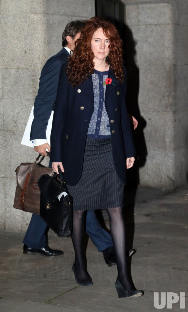 Rebekah Brooks and husband Charlie Brooks leave the Old Bailey Criminal Court.