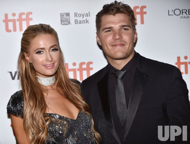 Paris Hilton and Chris Zylka attend 'The Death and Life of John F. Donovan' premiere at Toronto Film Festival 2018