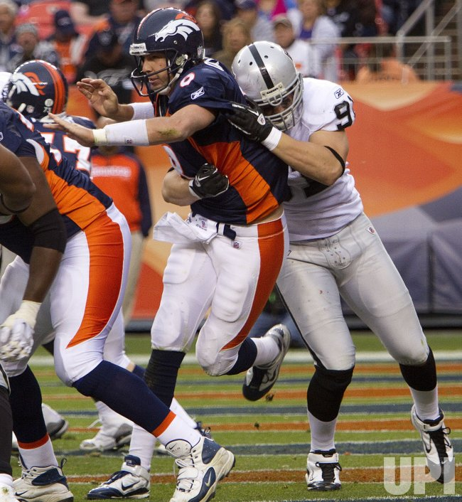 Raiders Scott Pressures Broncos Orton in Denver