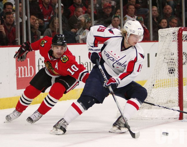 Capitals Backstrom skates as Blackhawks Sharp defends in Chicago
