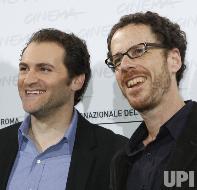 Michael Stuhlbarg and Ethan Coen arrive at a photocall during the Rome International Film Festival