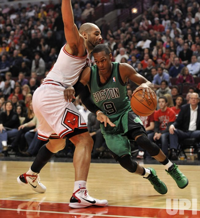 Celtics Rondo drives on Bulls Boozer in Chicago