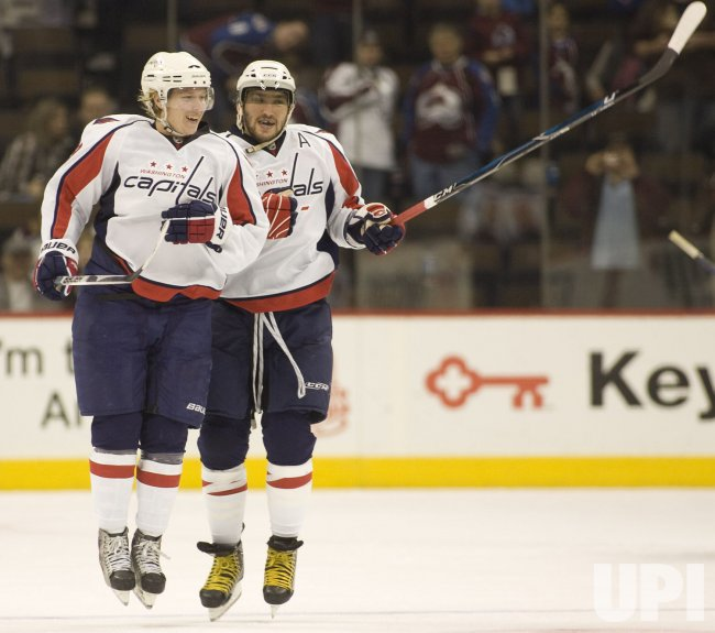 Capitals Backstrom and Ovechkin Celebrate Win in Denver