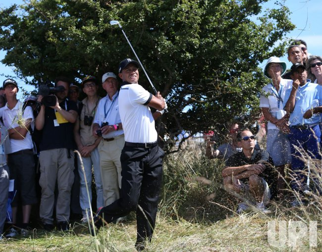 Tiger Woods plays out of the rough at the Open Championship