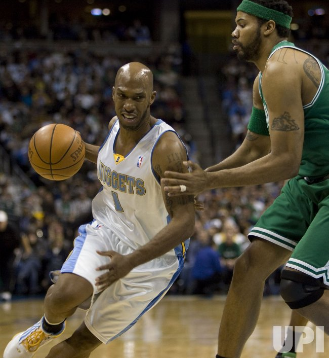 Nuggets Billups Drives Against Celtics Wallace in Denver