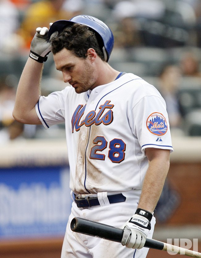 New York Mets Daniel Murphy walks to the dugout against the Arizona Diamondbacks at Citi Field in New York
