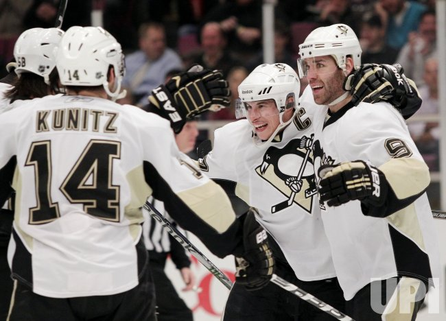 Pittsburgh Penguins Chris Kunitz, Sidney Crosby and Pascal Dupuis (9) react after a goal at Madison Square Garden in New York