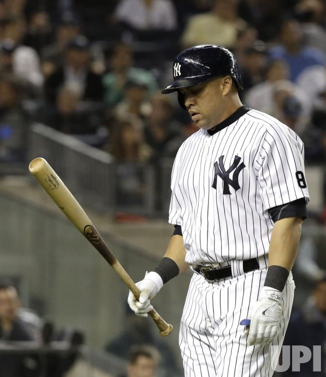 New York Yankees Carlos Beltran reacts after striking out