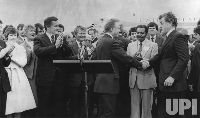 President Jimmy Carter is greeted by Senator Edward M. Kennedy at Logan Airport