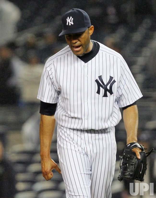 New York Yankees closer mariano Rivera reacts after giving up 2-run double to Boston Red Sox Jeremy Hermida at Yankee Stadium in New York