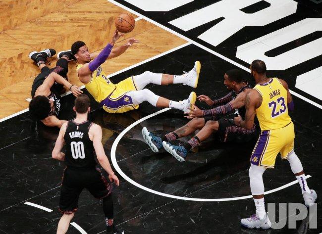 Lakers Josh Hart passes the basketball to LeBron James