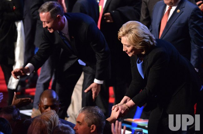 Democratic Presidential Candidate Clinton and O'Malley shake hands