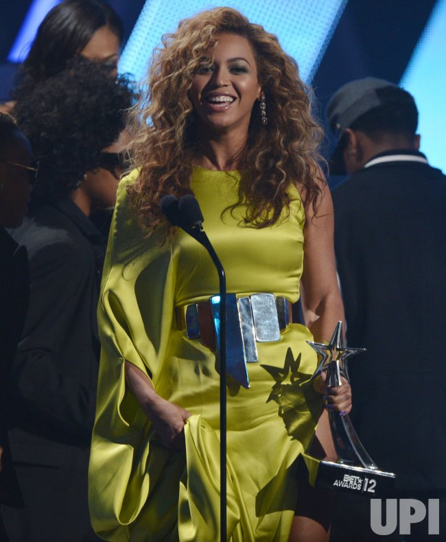 Beyonce accepts the Best Female R&B Artist award during BET Awards 12 in Los Angeles