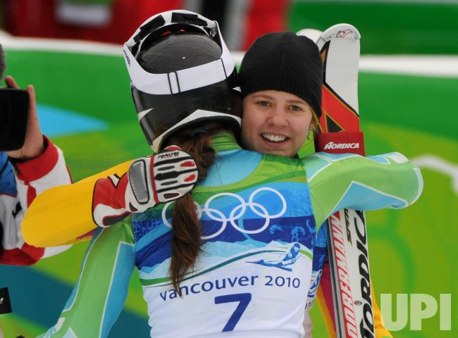Germany's Viktoria Rebensburg hugs Slovenia's Tina Maze during the Women's Giant Slalom in Whistler
