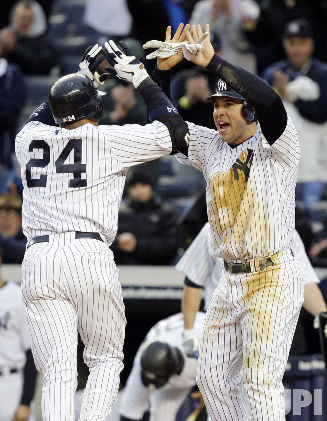 New York Yankees Robinson Cano and Mark Teixeira react at Yankee Stadium in New York