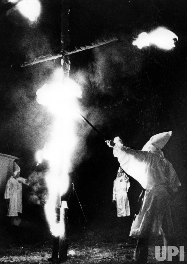 Ku Klux Klan members light a cross during a rally in Cly, Pennsylvania.