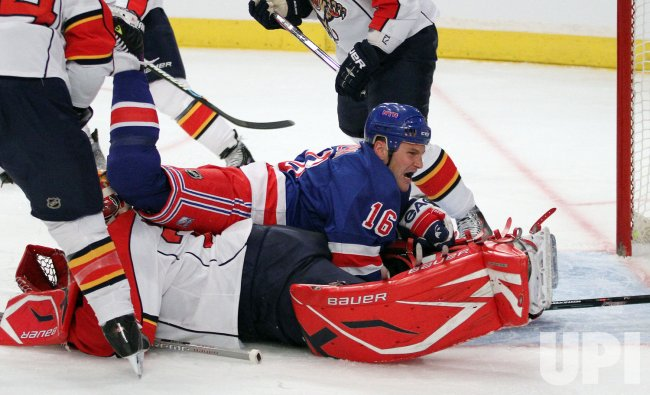New York Rangers Sean Avery reacts after landing on Florida Panthers Tomas Vokoun in the second period at Madison Square Garden in New York