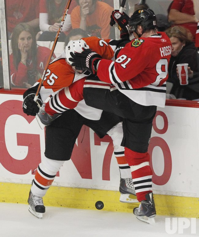 Carle and Hossa go for puck during the 2010 Stanley Cup Final