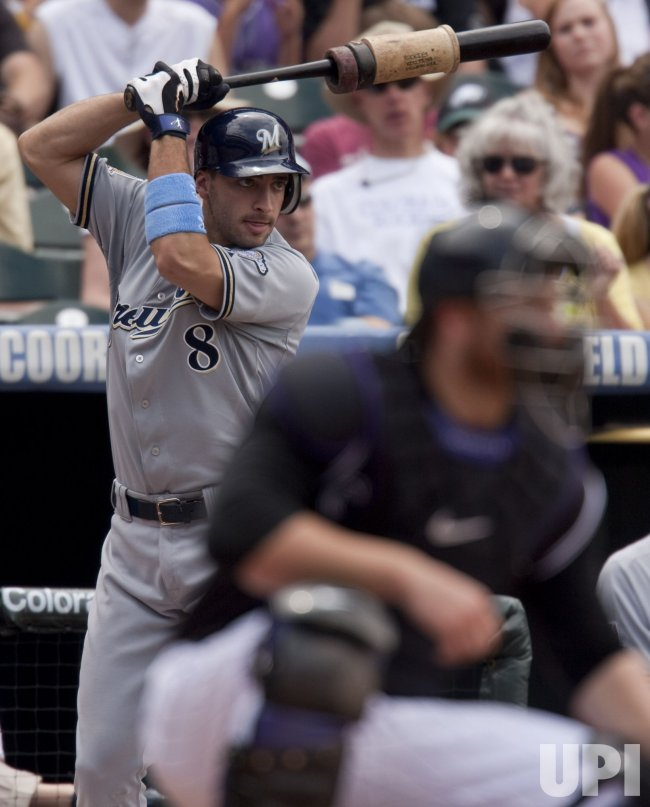 Brewers Braun Waits for His Turn at Bat Against the Rockies in Denver