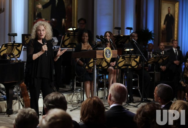 President Barack Obama awards singer-songwriter Carole King the 2013 Library of Congress Gershwin Prize