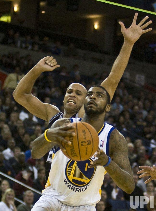 Warriors Dorell Wright pursued by San Antonio Spurs Richard Jefferson in Oakland, California