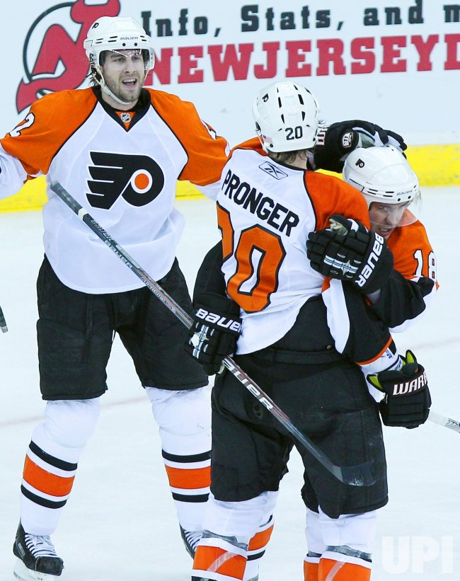 Philadelphia Flyers Chris Pronger reacts with Mike Richards in round 1 of the Stanley Cup Playoffs at the Prudential Center in New Jersey