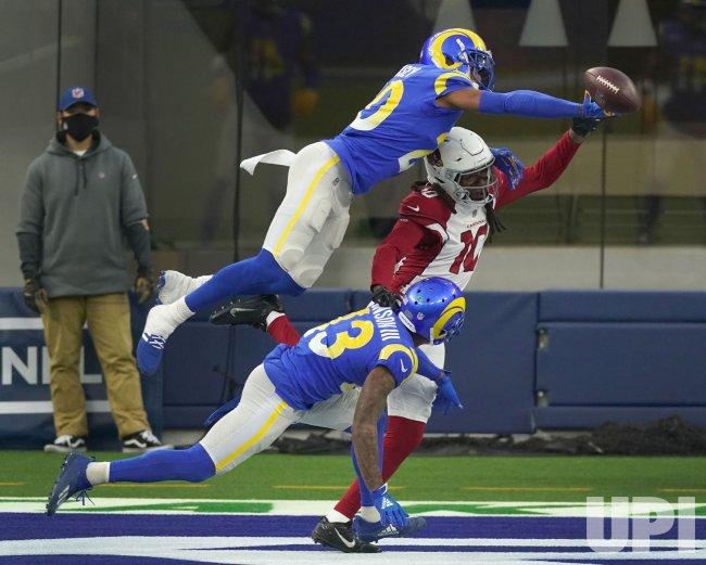 Los Angeles Rams cornerback Jalen Ramsey knocks the ball away from Arizona Cardinals receiver DeAndre Hopkins in Inglewood