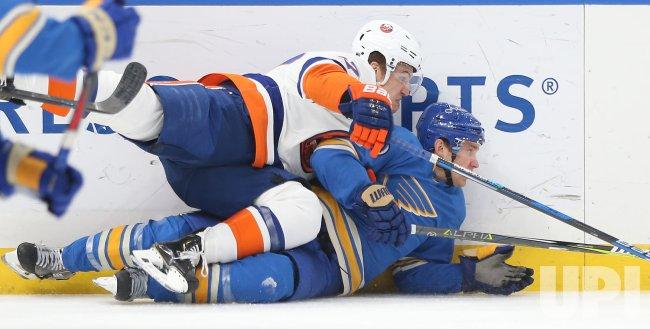 New York Islanders Anders Lee falls on top of St. Louis Blues Jaden Schwartz