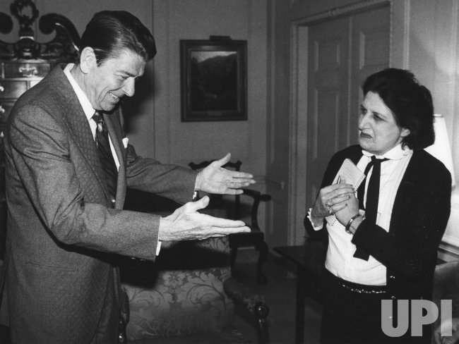 President Ronald Reagan greets UPI White House reporter Helen Thomas