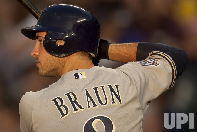 Brewers Braun Waits on Pitch Against the Rockies in Denver