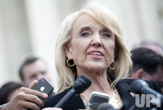 Gov. Jan Brewer speaks on Arizona's Immigration law in front of the Supreme Court in Washington