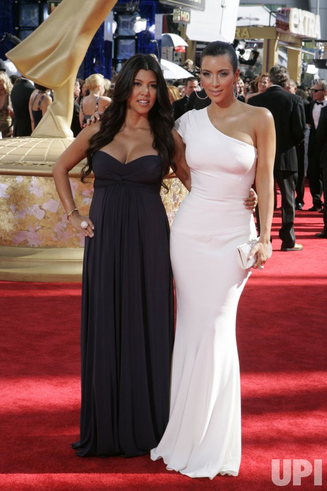 Kim Kardashian and Kourtney Kardashian arrive at the 61st Primetime Emmy Awards in Los Angeles