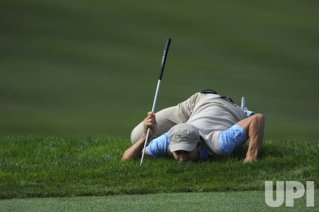 Camilo Villegas lines up a shot during the second round of the 2009 Presidents Cup in San Francisco