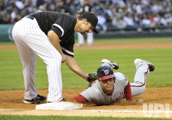 Nationals' Hairston slides into first agaisnt White Sox in Chicago