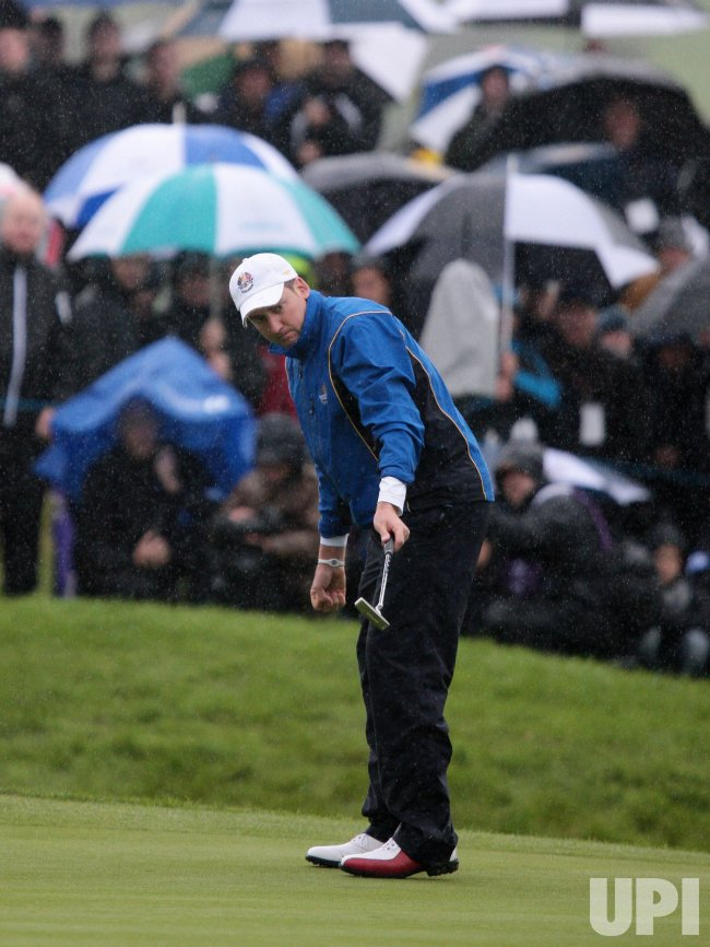Poulter celebrates birdie on the first day of Ryder Cup.