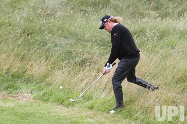 Miguel Angel Jimenez plays from the rough.