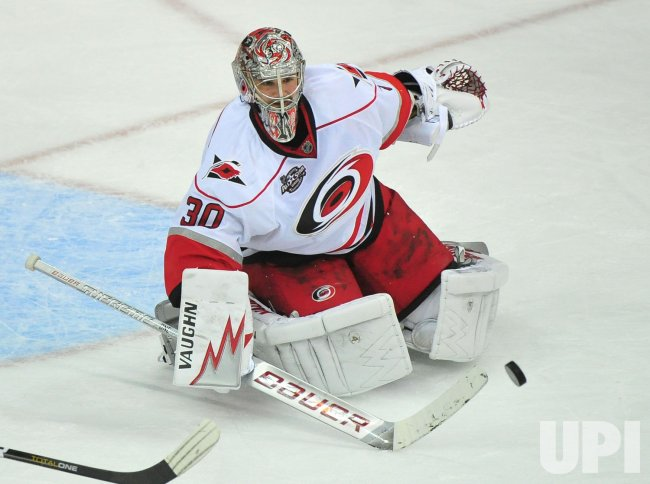Carolina Hurricanes' goalie Cam Ward stops a shot in Washington