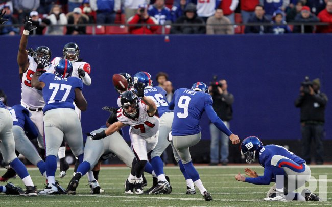 New York Giants Lawrence Tynes kicks a 36 yard field goal in overtime to defeat the Atlanta Falcons in week 11 of the NFL season at Giants Stadium in East Rutherford, New Jersey