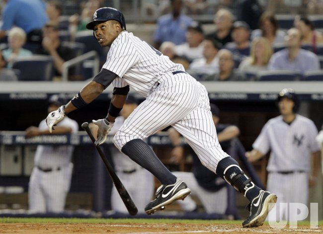 New York Yankees Curtis Granderson hits a solo home run at Yankee Stadium in New York