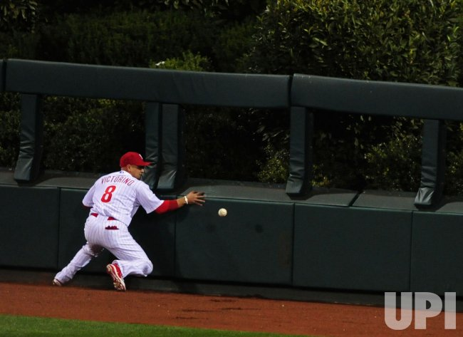 Phillies' Shane Victorino drops a catch during game 6 of the NLCS in Philadelphia