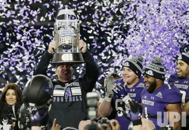 Northwestern Wildcats head coach Pat Fitzgerald celebrates
