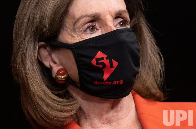 Speaker Pelosi wears a DC 51st State Mask on Capitol Hill in Washington, DC