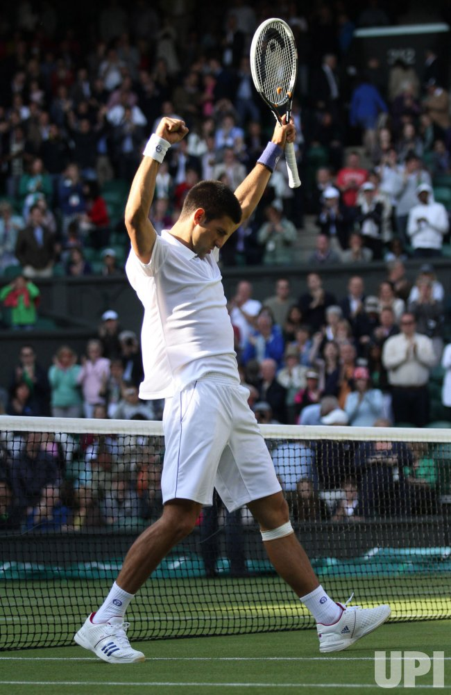 Novak Djokovic wins his match at Wimbledon.