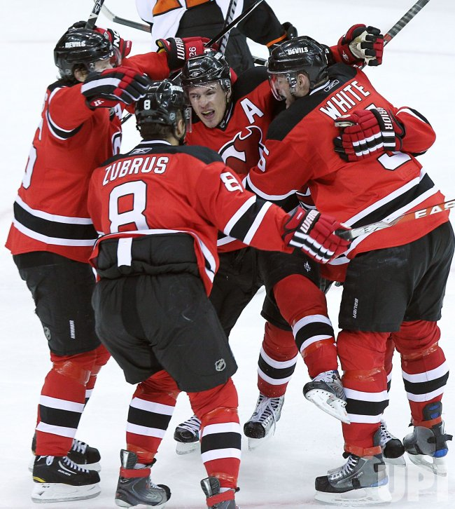 New Jersey Devils Zach Parise is surrounded by teammates after scoring a goal at Prudential Center in New Jersey
