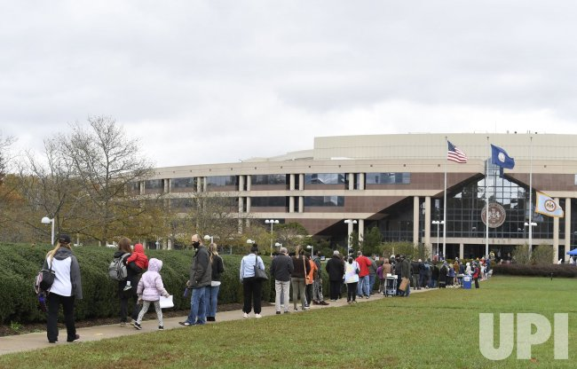 Early voters queue in long lines in Fairfax County, Virginia