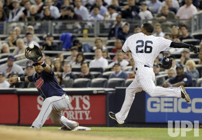 New York Yankees Eduardo Nunez and Cleveland Indians Carlos Santana at Yankee Stadium in New York