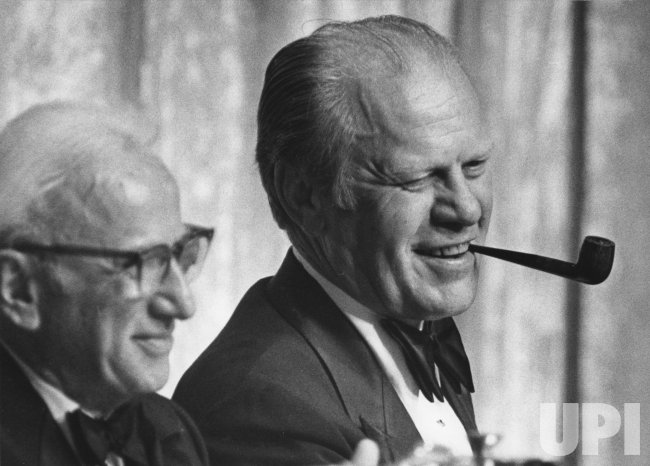 Gerald Ford smokes his pipe