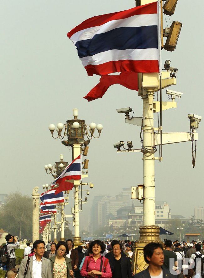 National flags of Thailand and China fly over Tiananmen Square in Beijing