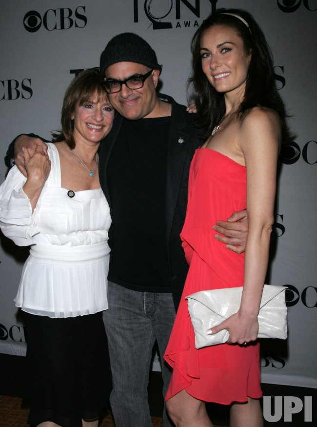 Patti LuPone, David Yasbeck and Laura Benanti arrive at the 2011 Tony Awards Meet the Nominees Press Reception in New York
